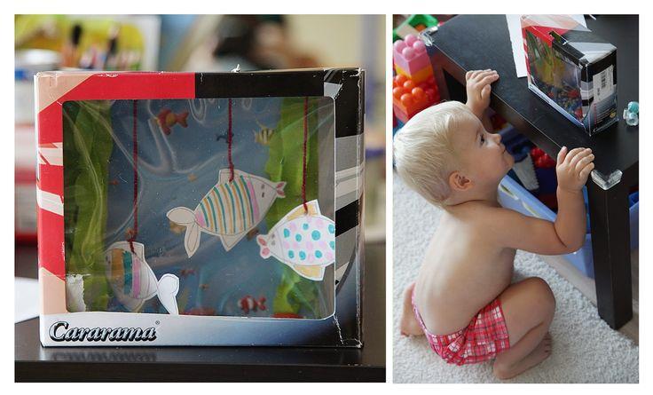 Самодельный аквариум и книги про рыб и морских обитателей. Чем занять ребенка.