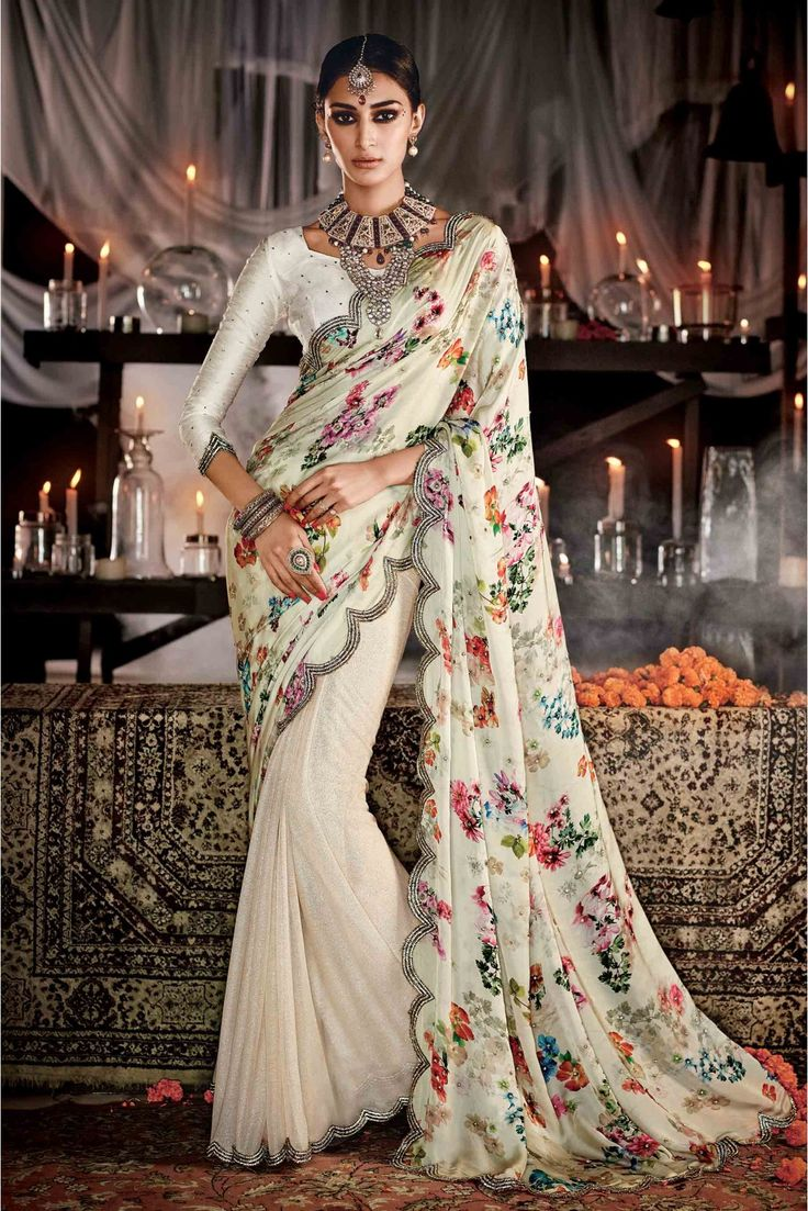 Cream Colour Net and Lycra Fabric Wedding Wear Designer Saree Comes With Matching Silk Fabric Blouse. This Saree Is Crafted With Diamond Work,Lace Work,Embroidery. This Saree Comes With Unstitched Blo...