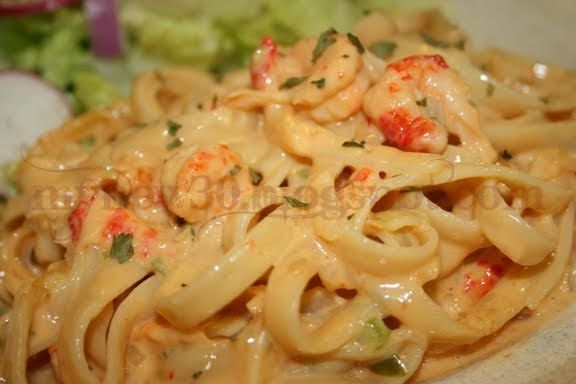 Crawfish in a creamy Velveeta cheese sauce served with fettuccine.