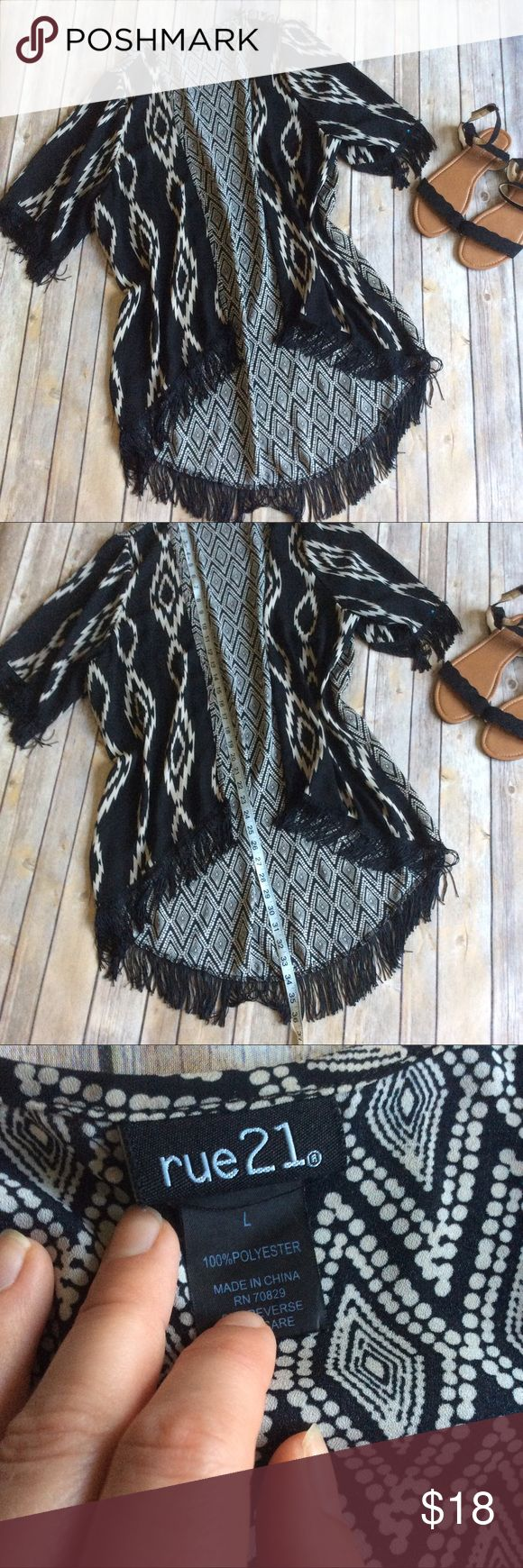 Rue 21 Long Fringe Kimono size Large Like new long fit Kimono with fringe detail at them bottom and at the sleeves. Perfect for pairing with tons of outfits! ❌no trades, holds, or lowball offers. ✅Clean and smoke free home, quick shipping, bundle discount, always! 🎁Free gift with $15+ bundle. Rue 21 Tops