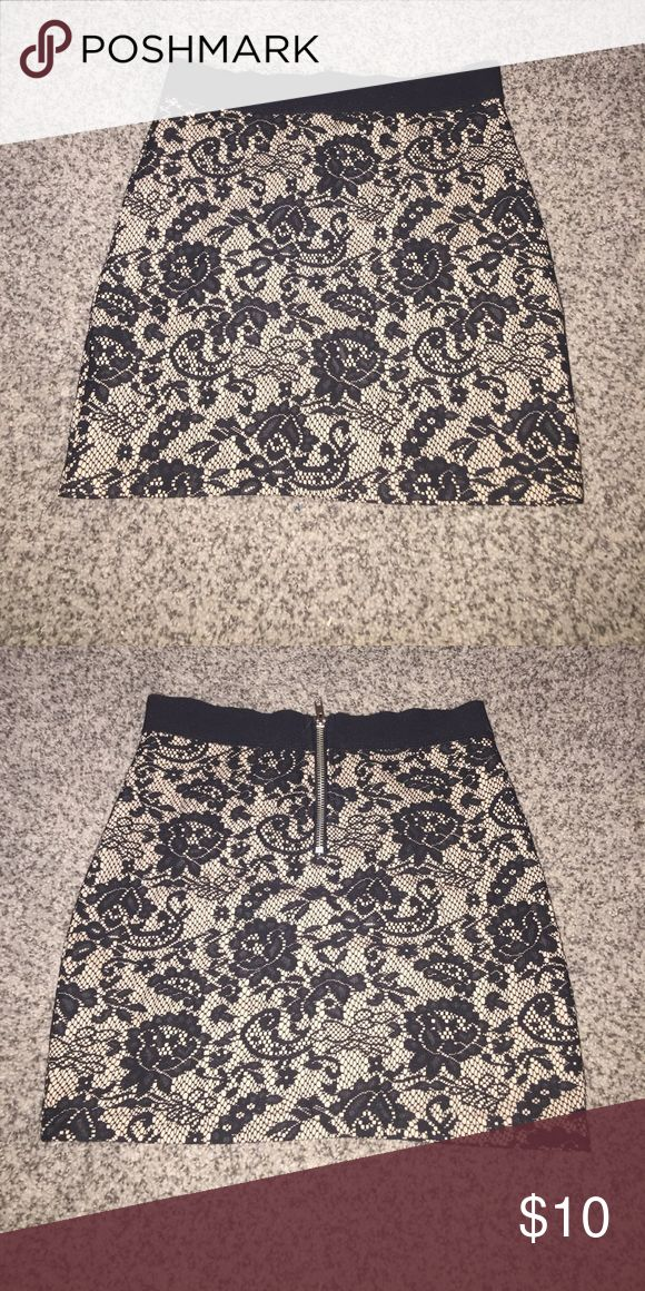Lace Mini Skirt A lace mini skirt I bought but it's too small, zips up in the back and is in great condition. Divided Skirts Mini