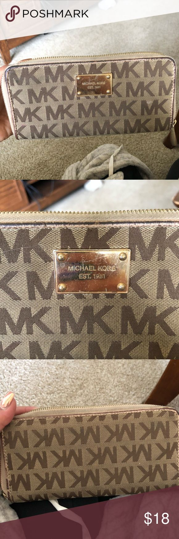 Michael Kors wallet! Golden brown Michael Kors wallet! Slight ware but not bad at all still a great wallet! Bought from Macy's, also have a matching purse I'm selling, will take best offer Michael Kors Bags Wallets
