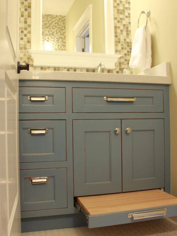 When designing a smaller bathroom for kids, smart details like this pullout stepstool can help save valuable floor space. Placing the sink off-center allows for three vanity drawers, space under the sink and maximum counter space. Design by Amanda Richards of Burlap & Denim