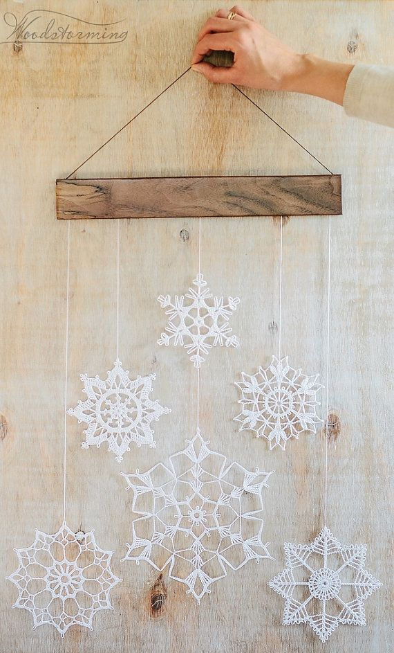 Elegant and delicate holiday decoration. Every single piece of this decoration is handmade with love. Christmas holiday decoration is made of walnut wood and 6 white crocheted snowflakes. Snowflakes are carefully shaped and starched and comes nicely and safely packed. Snowflakes mobile can hang on a wall, window, can become great nursery decor piece and warm interior element. We wish you best emotions using it!  Hang it indoors because snowflakes will lose their shape in wet environment…