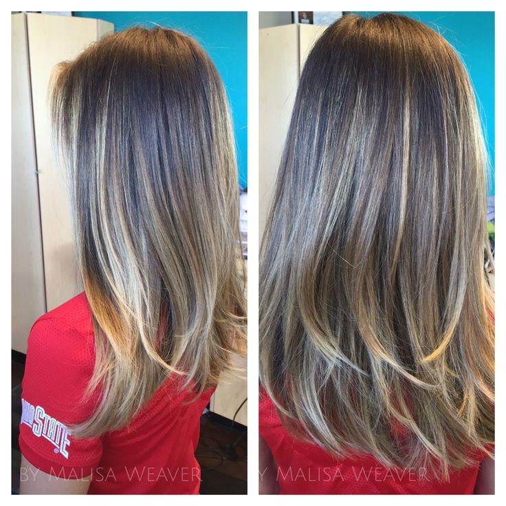 Nice straight layered hair cut.