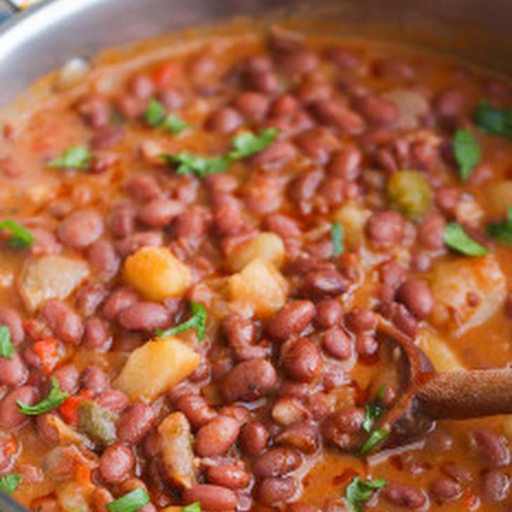 Puerto Rican Style beans Recipe with canola oil, cilantro, onions, jalapeno chilies, minced garlic, smoked paprika, cumin, cilantro, bay leaf, bell pepper, cayenne pepper, tomato sauce, small red beans, broth, large potatoes, goya sazon, fresh cilantro
