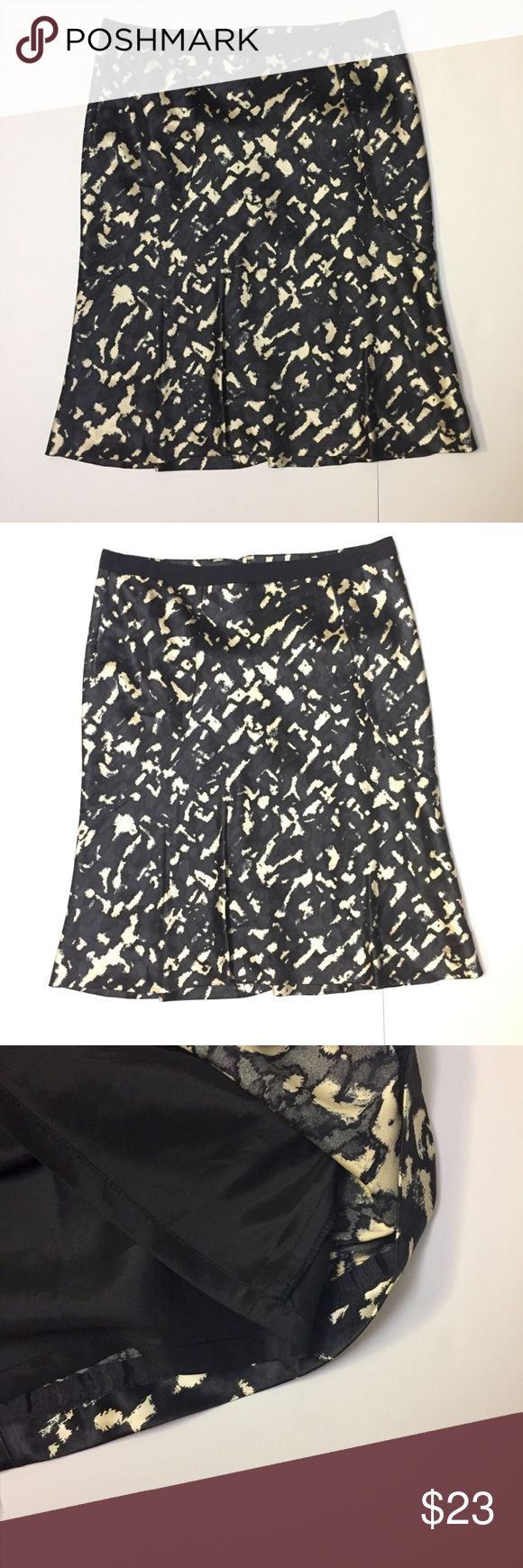 Ann Taylor silk black and cream color pencil skirt Ann Taylor silk black and cream color pencil skirt. In like new condition. No flaws. Fully lined. Back hidden zipper. Very wellmade. Fitted from hips. Size is 8. Ann Taylor Skirts Pencil