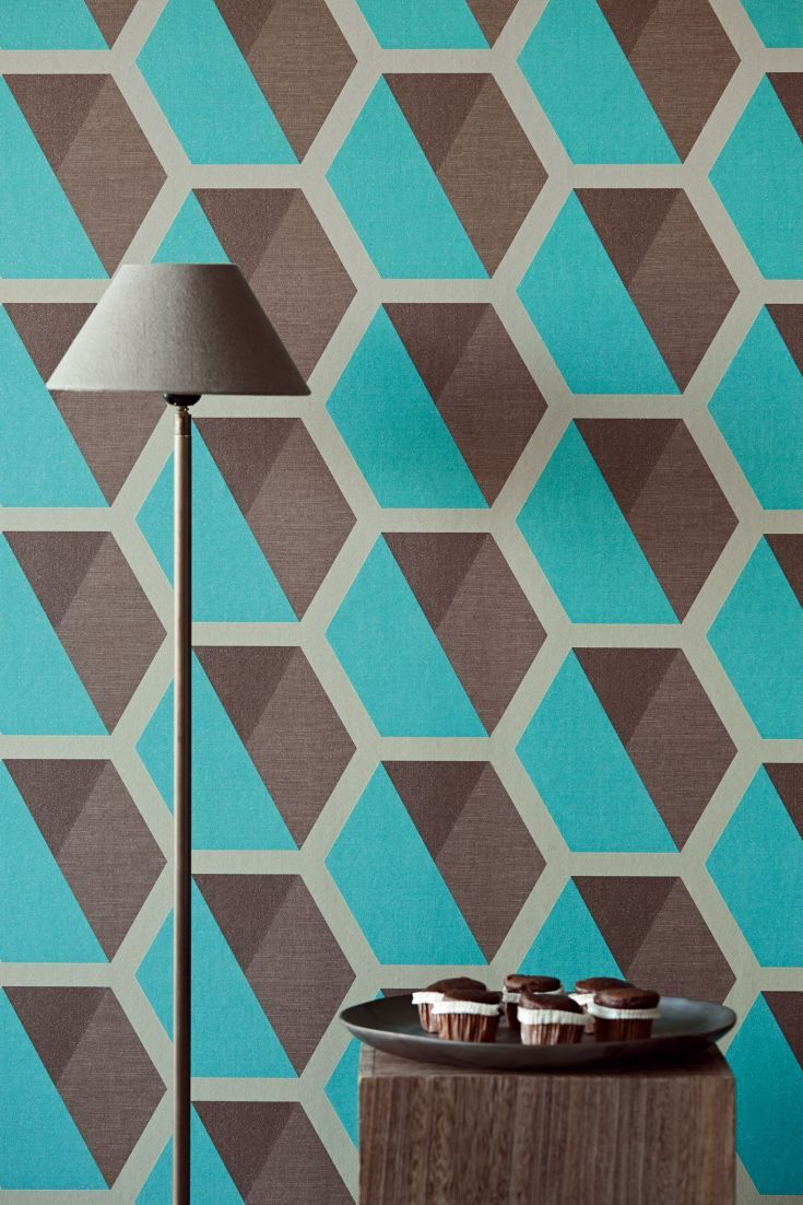 A bold hexagon shaped geometric wallpaper pattern, creating a honeycomb design in taupe,dark brown and deep jade green blue with a glitter detailing.