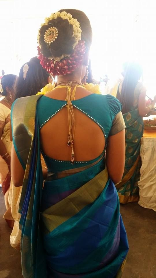 South Indian bride. Temple jewelry. Blue silk kanchipuram sari.Bun with fresh flowers. Tamil bride. Telugu bride. Kannada bride. Hindu bride. Malayalee bride.