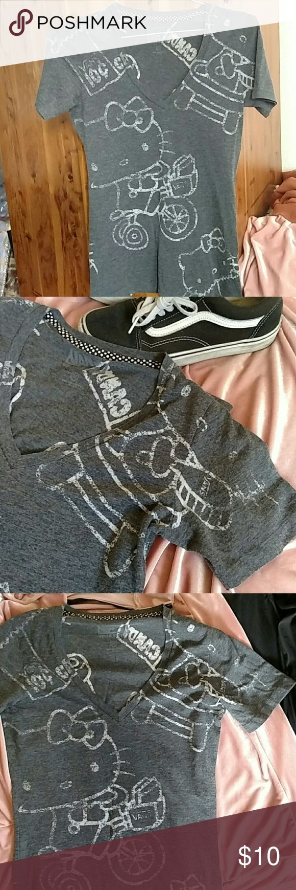 NWOT Vans Hello Kitty Shirt Super comfy and casual Hello Kitty collaboration with Vans T-shirt. V-neck. Size Medium. Stretchy and nice soft material. New without tags. Grey and white. Never worn. Vans Tops Tees - Short Sleeve