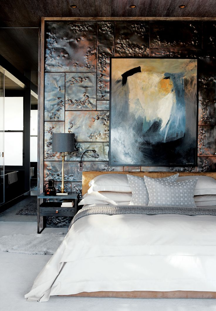 custom hammered copper tiles add texture and reflect light in the master bedroom of a cape town south africa penthouse the bed steel and walnut side - Metal Tile Bedroom Design