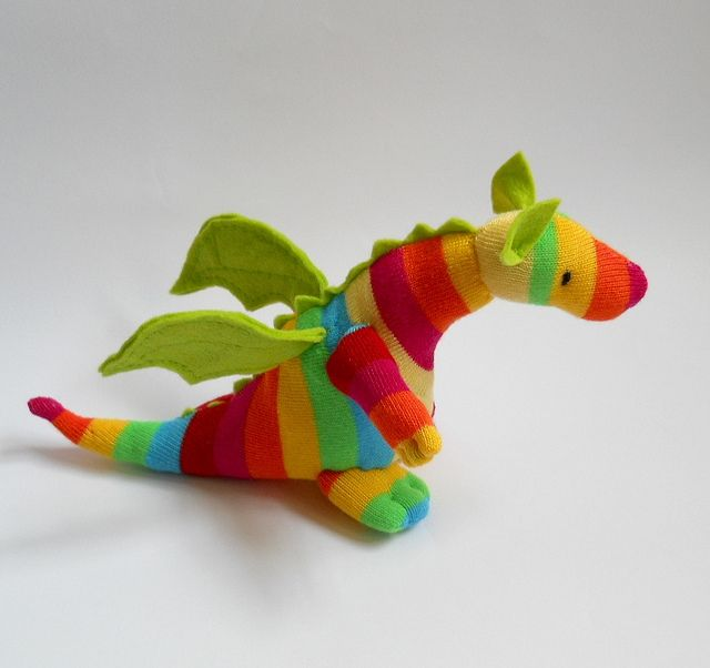 sock dragon by Treacher Creatures, via Flickr.  dollar store sock, felt wings, ears, ridges.