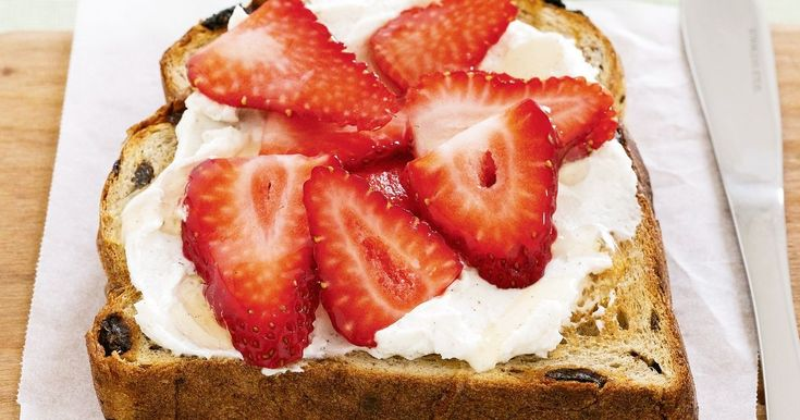 For a deliciously easy breakfast, top raisin toast with fresh ricotta and strawberries.