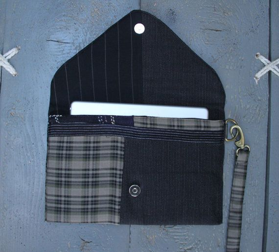 'Eating the goober' handmade everyday ipad case made from recycled men's clothes and brand-new textiles.It can also be used as a stylish envelope purse. Colors different shades of beige , black