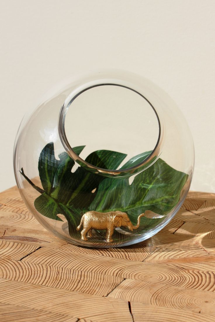 This tiny elephant was right at home in a miniature terrarium vase.  www.pinkpumpkinevents.com