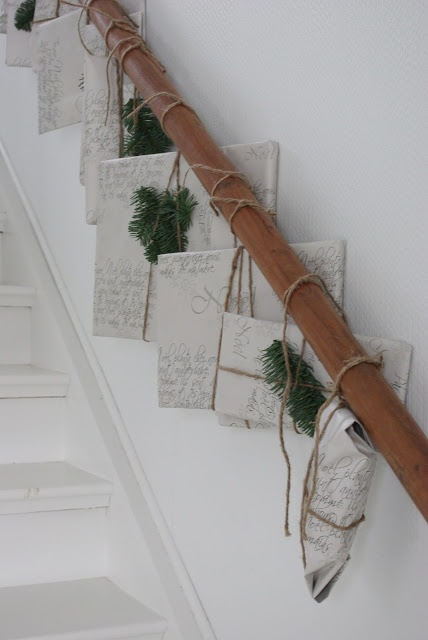 wrapped & tied to banister. I can't read it, but this would be a cute idea for a book to read each day until christmas