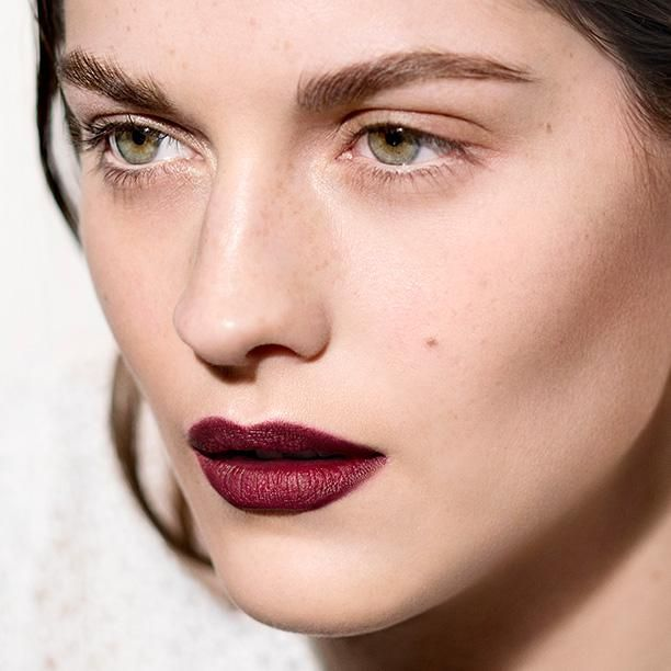 On the Burberry Velvet and Lace set: Amber Anderson with radiant skin and oxblood lips