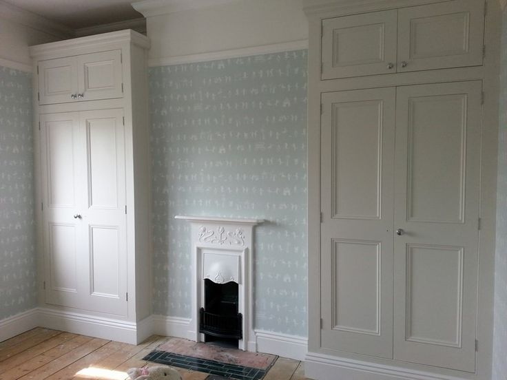 Bespoke alcove wardrobes in Ware, Hertfordshire. Doors traditional handmade Poplar, hung on butt hinges.