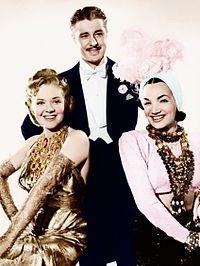 "Alice Faye , Don Ameche and Carmen Miranda in That Night in Rio"" 1941 wearing Joseff of Hollywood jewelry."