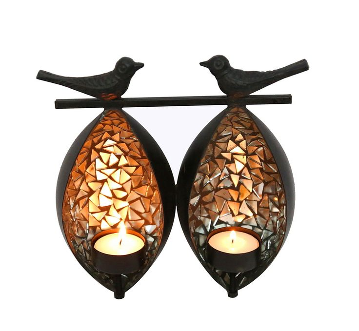 These twin birds tea light holder lends a warm and exclusive look. Silver and Black colours gives a classy look.