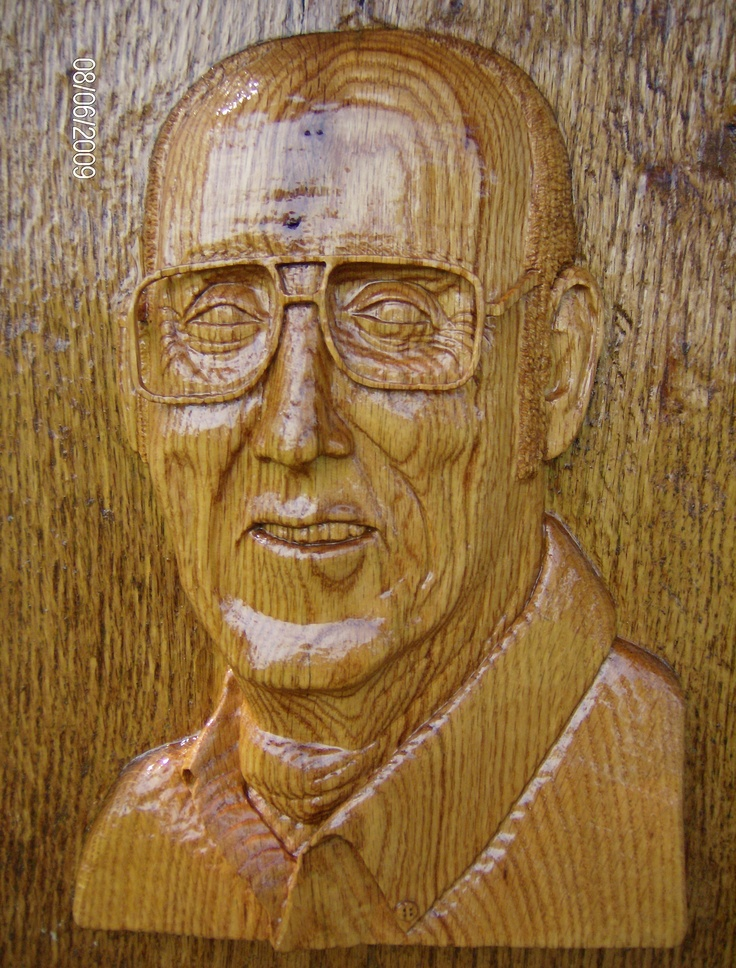 Portrait in red oak wood high relief d glasses are