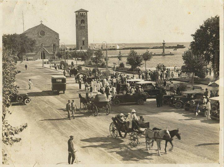 The Mandraki harbour of Rhodes. A busy main road.