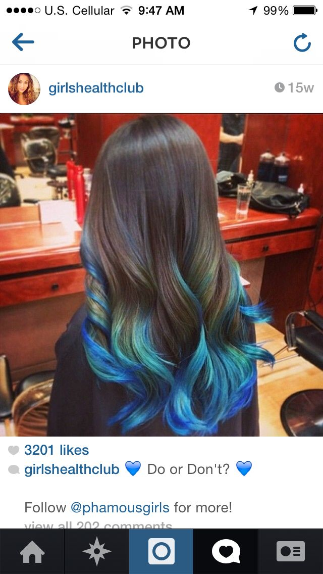 black hair with blue/teal tips/highlights