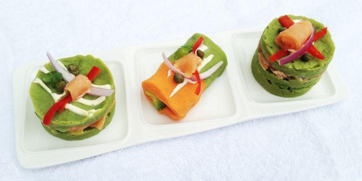 Arcoiris de causitas al cilantro y morrón, rellenas con salmón ahumado, paltas y alcaparras.