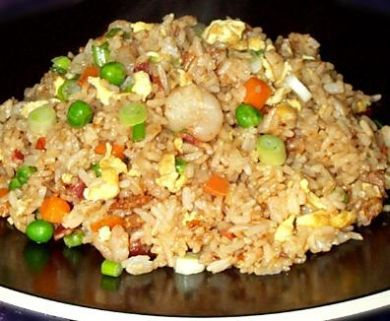 Chicken Fried Rice - 3c steamed rice (Prepared. 1.5c rice, 1.5c water in steamer) ~ 2 sm chicken breasts, cooked ~ 2 eggs, scrambled ~ .25c onion, chopped ~ .5c carrot, chopped ~ .25c celery ~ .25c green onion, chopped ~ 2 tsps oil (for veggies) ~ 1tsp sesame seed ~ .5tsp pepper ~ 2 dashes salt ~ 4 cloves minced garlic ~ 2 tsps fresh grated ginger ~ 4 tbsps butter ~ 2 tbsps soy sauce