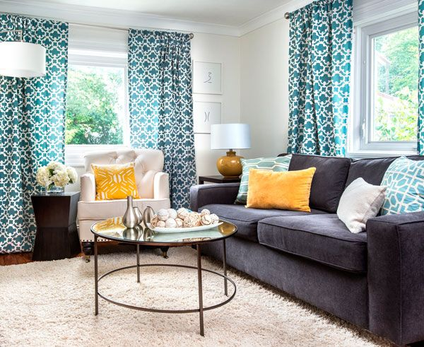 .Carriage House Living Room by Brittany Zachos- love the use of yellow and turquoise with gray & the patterned curtains and pillows.