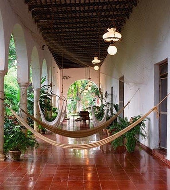 Mexican Hacienda patio featuring hammocks,  gorgeous tile work, columns