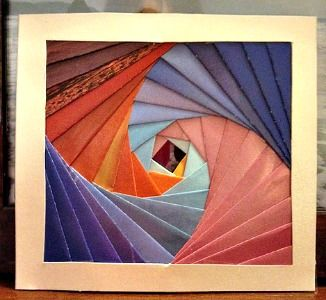 This iris folding pattern for a square image is beautiful. The color choices for the different types of paper are so unique.
