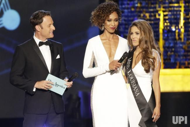 Hosts Chris Harrison and Sage Steele listen to Miss Louisiana Laryssa Bonacquisti answer a question at the 97th annual 2018 Miss America…