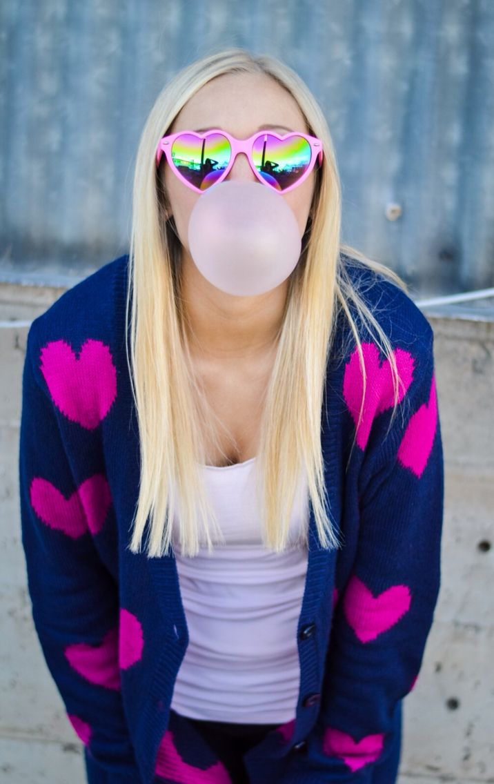 Valentine's Day inspired shoot featuring bubble gum and heart sunglasses