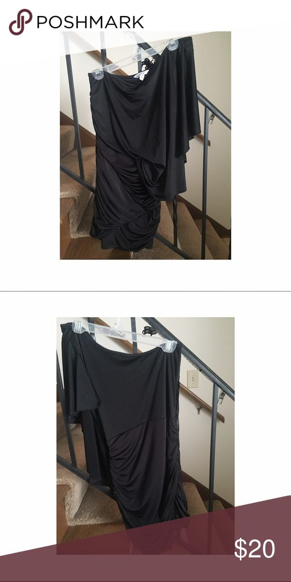Black one shoulder dress Black one arm dress, and form fitting. Has been worn couple of times for dances. Dresses