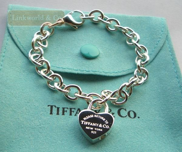 Want this Tiffany charm bracelet with the St. Christopher medal or other meaningful charm