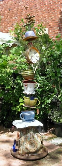 garden totem of teacups and clocks