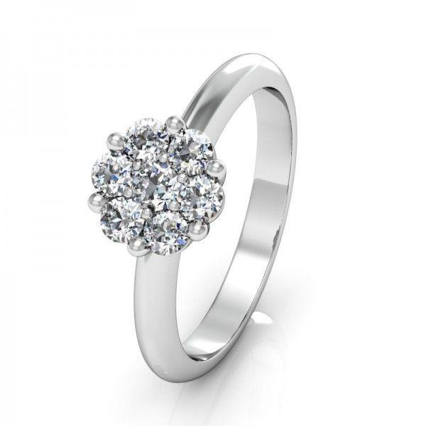 Der Verlobungsring Flower besitzt 7 kleine Diamanten, wodurch der Ring wie ein großer Diamant wirkt. Atemberaubend schön. #flower #love #luck #mariage #diamond #gold
