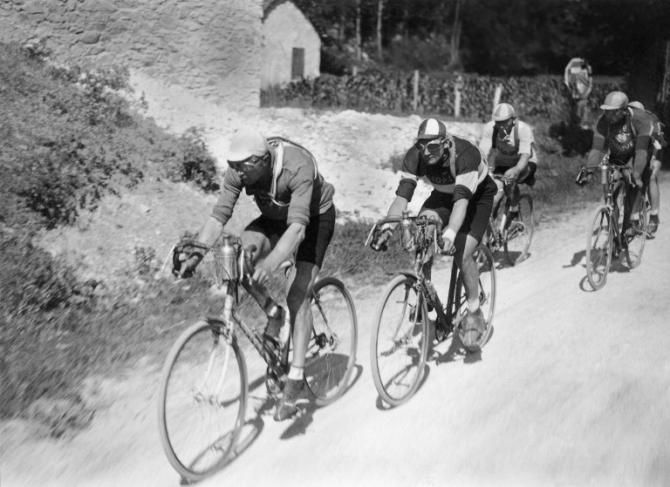 Luxembourg's Nicolas Frantz, wearing the yellow jersey as leader of the Tour de France, rides in front of Frenchman Andre Leducq on July 2, 1927, during the 12th stage between Luchon and Perpignan. Frantz went on to win his first Tour de France as Leducq finished 4th overall.