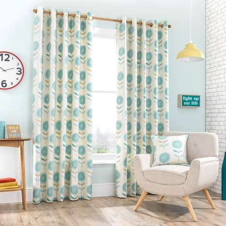Fabricated with a soft cotton face and a durable polycotton reverse, these lined eyelet curtains are printed with large floral designs in teal blue on a natural...