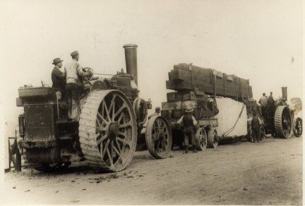 Quarry owners 'Freemons of Pehrhyn' hauling a block of granite with their engines 'Epsilon' and 'Zeta'. The granite was to form the base for King Alfred's statue in Winchester, and was transported from Cornwall by train. A Wallis and Steevens engine was used to haul the load from Winchester station to the site of the statue which was cast at the Thames Ditton art foundry.
