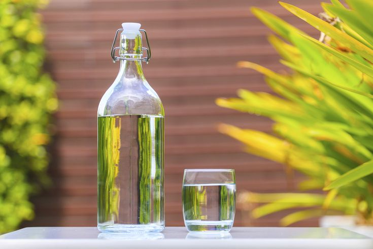glass bottle with water_Easy Eco-Habits - Eco-habit: Pitch plastics    You got rid of all your bisphenol A (BPA)-containing water bottles and canned foods – plastic problem solved, right? Not so fast.