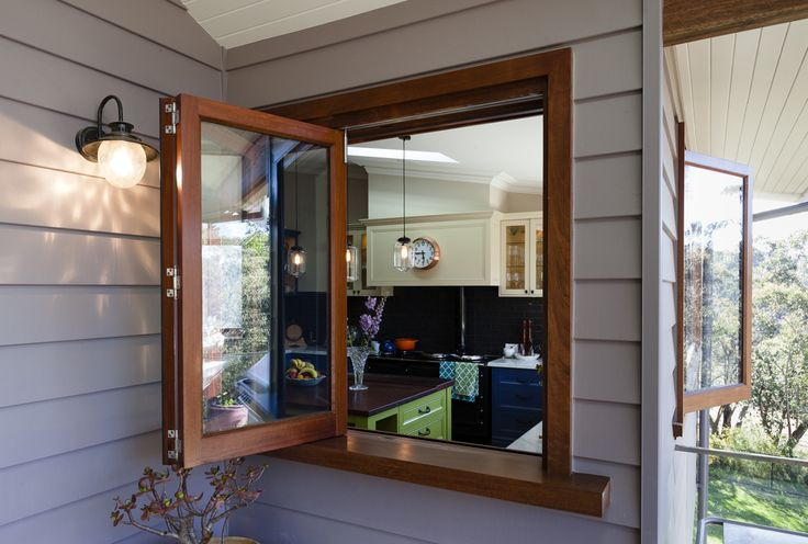 Red Gum bi-fold window by Against the Grain Windows & Doors - the perfect servery from kitchen to outdoor entertaining area