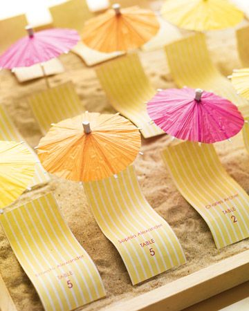 Play up a beach theme with these petite chaise longues and parasols.