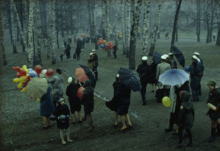 People strolling through a park in Finland during a wet May snowstorm, 1968.Photograph by George F. Mobley, National Geographic