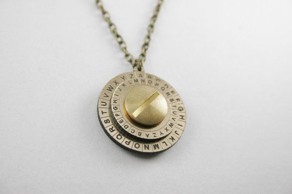 This cipher wheel necklace is both lovely to look at and precisely made. The top disk spins freely, allowing the pendant to be used for encoding and decoding