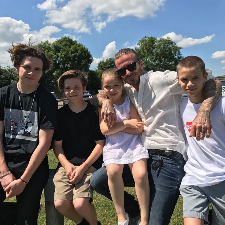"""Victoria Beckham - Victoria called husband David """"the best daddy in the world"""" in this adorable family photo, but may we also suggest adding """"the most handsome""""?"""