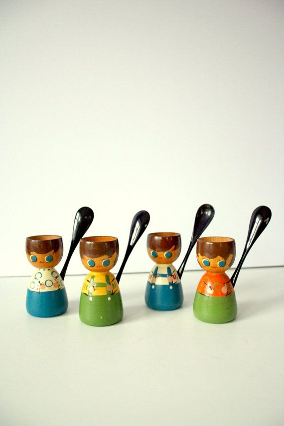 I want these egg cups....they even carry their own spoons....adorable!