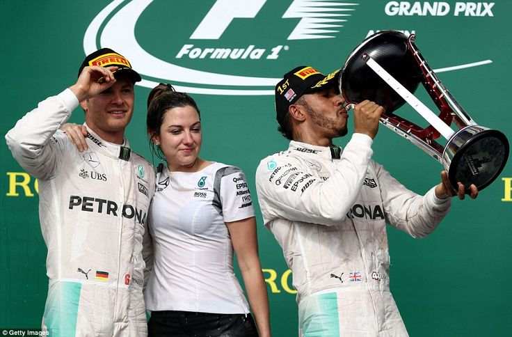 Ending five races without victory, Hamilton kept alive his fading title hopes in the United States with his fifth victory in the country. The Brit celebrates the triumph by drinking out the winners' trophy as second-placed team-mate and title rival Rosberg stands with a Mercedes colleague on the Circuit of the Americas podium