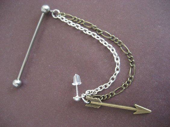 OMG. Industrial Piercing Barbell Bronze Arrow Head Upper Ear Cuff Chain Dangle Charm 14g 14 G Gauge Bar Jewelry. $18.20, via Etsy.